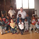 Mike Thomas with some of the children
