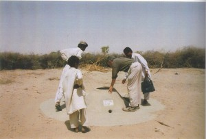 fioh.fund.pakistan.participatory.village.development.programme. Poverty alleviation in the Thar Desert. Eddie Thomas inspecting water cistern