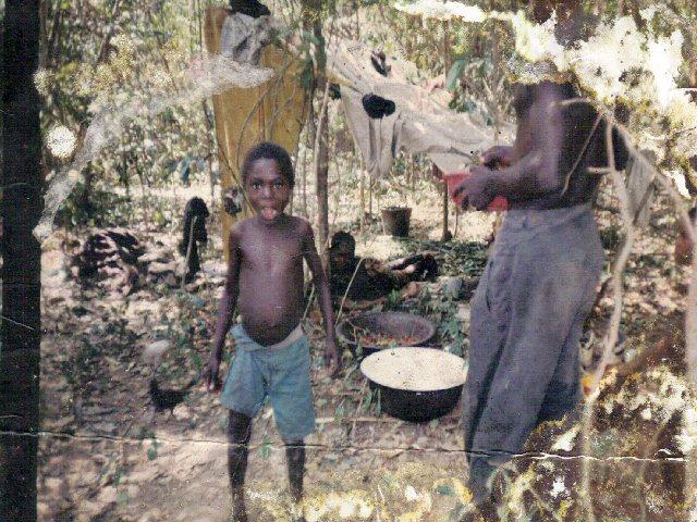 sierra.leone.post.war.reconstruction. Edward Kargbo's family living in the bush 1998