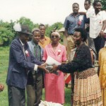 ROMULUS WNDERA AND ERNEST OUMA WITH WOMENS GROUP