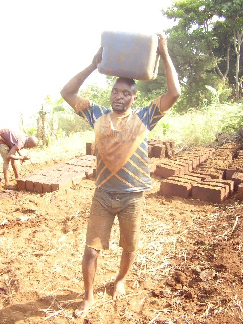 fioh.fund.cameroon.glores. Making blocks for the new treatment centre. Collecting water from stream