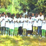 plant.a.tree.in.africa.ethiopia. Children planting tree seedlings with Mussie Hailu